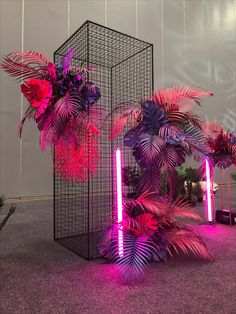 Black entry cage with purple and pink monsteria and golden cane leaves Neon Jungle, Neon Flowers, Luxury Wedding Decor, Flower Installation, Custom Neon Signs, Neon Party, Wedding Mood Board, Photo Backgrounds, Neon Lighting
