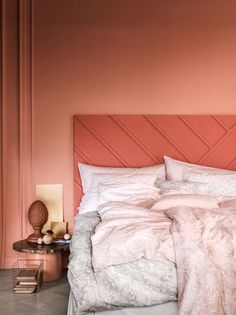 pink and coral bedroom walls with pale pink bedding. / sfgirlbybay
