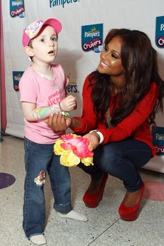 """Brooke sings the """"Rainbow Song"""" to Christina Milan and gives an awareness blossom to her baby girl... Violet"""