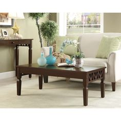 Decorate your living room with this lovely brown rubberwood coffee table measuring 22.1 inches tall and 42.1 inches wide. Small detailing shows on the four (4) legs to match the etching on the two ends.