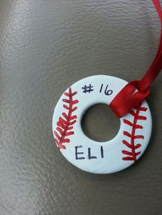 Baseball washer necklace I made. I am going to remake this using a VERY fine tip red market or pen. The fine tip sharpie was sloppy. Anyway, PLAY BALL!