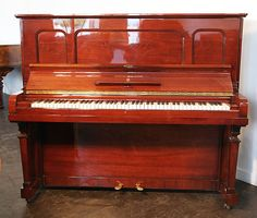 A 1925, Steinway Model K vertegrand upright piano with a mahogany case   at Besbrode Pianos