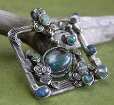 Blue Swan. Sterling silver with apatite, peruvian chalcedony, emerald, kyanite, labradorite, blue peruvian opal, blue mystic quartz, sapphire, tanzanite and clear topaz.