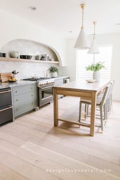 Modern Farmhouse Kitchen by Design Loves Detail - Arch in Drywall for Vent Hood - Unique Vent Hood Design - Interior Design - Home Design - Open Island - Table for Kitchen Island Basement Kitchen, Kitchen Family Rooms, Kitchen Dining, Kitchen Island, Modern Farmhouse Kitchens, Farmhouse Design, Farmhouse Decor, Farmhouse Style, Kitchen Lighting Fixtures