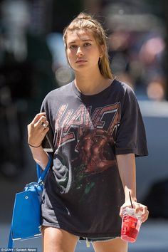 Rock chic: The 18-year-old cloaked her petite frame in a baggy T-shirt that had 'Slayer' w...