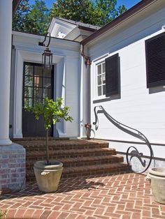 Classic southern style in Charlotte.  love the railing, and light