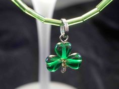 Girl guide trefoil (clover) by periwinkledzyn, via Flickr  They are 6mm green hearts on 2 head pins with an eye pin for the center , ends twisted to make the stem.