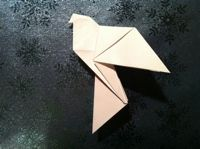 origami dove... won't these look lovely suspended on strings?!