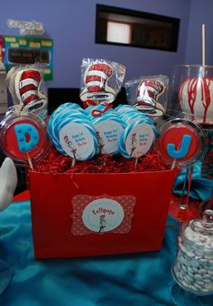 Everything about the cat in the hat party on this website is perfect! Love the centerpieces, candy bar, candy apples, everything!!