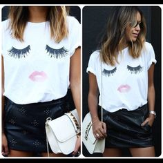 Lips and Eyelashes Graphic Tee NEW Lips and Sparkle gem EyeLashes Graphic Tee , loose fit , 100% Rayon , soft material .  NEW  PLEASE DO NOT BUYCOMMENT  ON YOUR SIZE AND ALLOW ME TO CREATE A LISTING FOR YOU.  Size up if you want that tug in look. Tops Tees - Short Sleeve