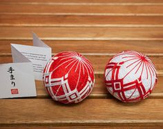Each Temari is packed in a little origami folded box and comes with a little info booklet.  The listing is for 1 (one) ball, please specify which one from the photo you prefer. The left is white and the right is red. This is a Made-to-order item.  Please drop me a note if you want to add a hanging thread.  If you want different color or quantity, please do not hesitate to contact me. I will be glad to do it for you. There will be no additional charge, but sending time will be at least 3-4…