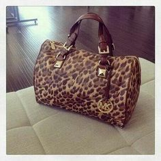 Michael Kors animal print handbag