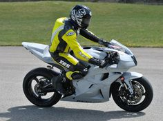 Matt Kent rides the BOLT electric motorcycle, achieving a top speed of 98.5 mph.