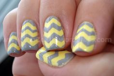 Yellow and Grey chevron nail design