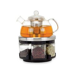 Perfect for the tea aficionado, this set has everything you need to experience the fresh, pure and complex flavors of loose leaf tea. Includes a glass teapot, retracting kettle tray/rack, and six glass tea canisters filled with 6 kinds of loose tea.