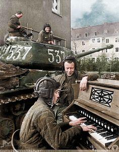 Crew members of Nº537 Soviet IS-2 tank of the 87th Guards Heavy Tank Regiment take a break in Breslau (now Wrocław in Poland) 27th April 1945. Commander - Lt. B.I.Degtyareva The musician is B.W. Kalyakin