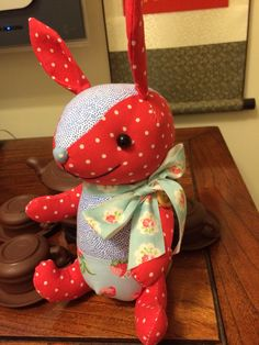 Polka-dot red and blue fabric bunny with Cath Kidston ribbon.