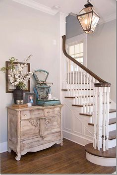 Inside – the stairs are original – they were just painted and repaired, as needed. Joanna added the trendy lantern. Walls are a soft gray,...