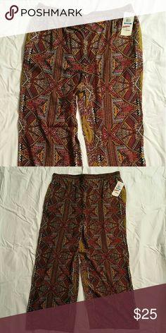 NWT Vince Camuto Palazzo pants Tribal print palazzo pants...elastic waist...regular length with a little overhang  (I'm 5'7)...2 side pockets Vince Camuto Pants Wide Leg