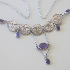 """An Edwardian silver and natural Amethyst """"man in the moon"""" necklace."""