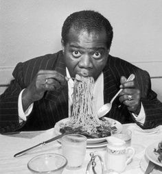 Louis Armstrong eating spaghetti.
