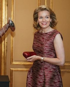 Queen Mathilde of Belgium poses during the inauguration of the exhibition '@yourservice', organized by the Belgian Foreign Affairs at the Egmont Palace in Brussels on the occasion of the National Day on July 17, 2015.