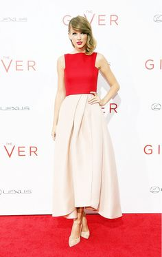 Taylor Swift wears a red and blush pink midi dress with matching heels