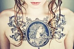 Cameo brooch womens chest tattoo