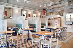 Located in Sopot, Poland, the Fanaberia Crepes & Cafe is a bright and cheerful establishment designed by PB / Studio with colors inspired by the ocean.