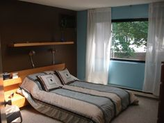 blue and brown bedroom walls with white strip | bedroom wall color