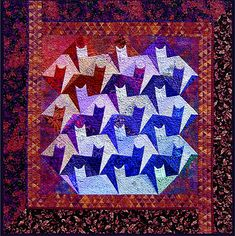 California Stars by Paula Golden.  This 'tessellating tabbies' pattern is by Jinny Beyer.