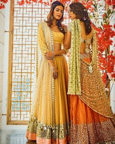Vibrant colours teamed with mirror embellishments in traditional silhouettes by are quintessential this wedding season. Western Dresses, Indian Dresses, Indian Outfits, Indian Clothes, Indian Lehenga, Silk Lehenga, Indian Attire, Indian Wear, Indian Style