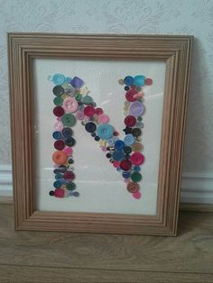 Framed button letter N for Nancys nursery! Using an old frame, nice card and mixed buttons to match the colour of the giraffe.