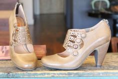 Step out in style this season with the #MizMooz women's Sharon pump! A beautiful decorative leather piece over the front is embellished with an intricate cutout design and buttons along the lateral side. The zipper enclosure at the heel and a small, elastic gusset make getting the Sharon on/off simple while a cushioned insole provides optimal comfort. Available in Khaki $139.95. elosshoes.com