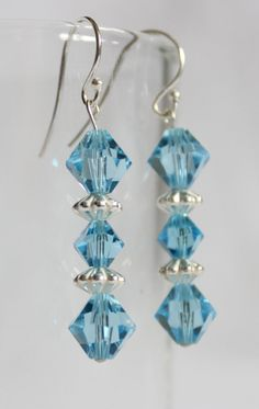 Hand made earrings featuring Blue Swarovski crystal and sterling silver spacers and posts.