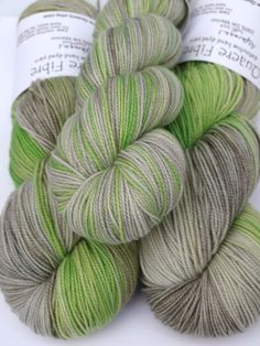 A light grey with shades of green. This yarn is a 2-ply with a firm twist, which makes it more durable and gives it a cabled appearance.    100% Superwash