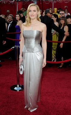 A year after finally winning the gold, Winslet gave her best Old Hollywood approximation in silver Atelier Yves Saint Laurent by Stefano Pilati. The strapless bustier gown was accented by side-swept hair, over $3 million in Tiffany diamonds, and Yves Saint Laurent satin clutch and sandals.