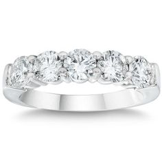 Pretty wedding band, but I'd totally love it as an engagement ring/wedding band in one : )