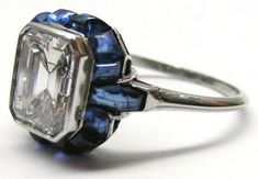 Lovely diamond and sapphire ring. Via Diamonds in the Library.