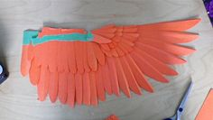 The paper wing I have been working on for the several days. I am making it to use as a reference for drawing. All the feathers are individually cut, folded, and taped in place.