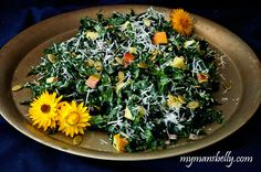 A colorful shredded kale salad full of delicious Fall flavors like apples, pumpkin seeds and Parmesan cheese. Healthy recipes can be comforting too.