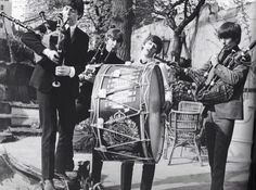 The Beatles playing pipes and drums