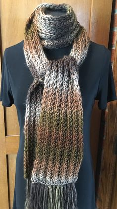 Free Knitting Pattern for One Row Repeat Acceptance Scarf - Easy scarf features a one row repeat stitch pattern and looks great in any yarn including multi-colored yarn. Designed by Myrna A.I. Stahman who dedicates the pattern to fostering an understanding of people who are different from ourselves