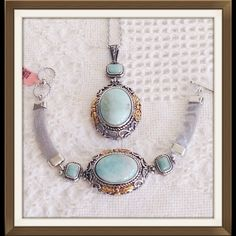 Russian Amazonite Set TGW 100.0 NEW Genuine Russian Amazonite Bracelet (7.5 in) and Pendant With Chain (20 in) in Stainless Steel TGW 100.000 cts. Russian Amazonite can be found in a few known locations, however, the best quality stones are found in Russia. Located 50 miles southwest of Chelyabinsk, Russia, in the area of Miass in the Ilmen Mountains, Russian Amazonite is sourced from granitic rocks. This is a natural stone, no enhancements. Jewelry
