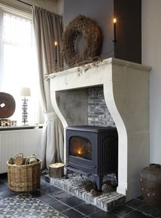 Love the stone mantle fireplace around this wood burner and the tiled