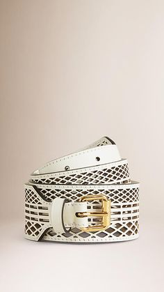 Burberry leather belt with a cut-out mesh design. Measuring 4.5cm/1.8in wide, the belt fastens with a metal buckle closure. Discover more accessories at Burberry.com