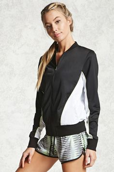 An athletic track jacket featuring a colorblock design, zipper front, ribbed neckline and trim, long sleeves, and front slanted snap-button pockets.