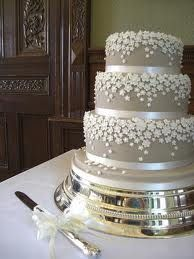 silver wedding cake with white   (and pink!) flowers