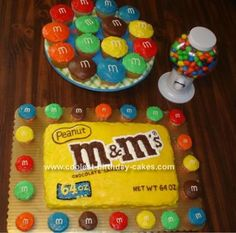 M & M's Cake: My dad helped me make this M cake for my mom who loves m's.  Took a 9x13 pan and decorated it by using the candy bag for reference.    Made little