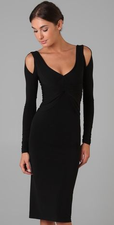 Absurdly chic not-so-little black dress.  Pleating, draping, and cut-outs paired with a body-skimming silhouette and a knee length hem makes this dress sophisticatedly sexy.  Zac Posen, $1995.
